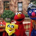Elmo and Super Grover pose with the four 'super' food groups (Fruits, Vegetables, Dairy, and Grains) as part of Sesame Street's Food For Thought initiative. © 2010 Sesame Workshop. Photo by: Richard Termine.