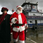 Santa Claus will float into Petaluma aboard a tugboat on Saturday, November 24th, just as in past years to kick off the holiday season. (John Burgess/PD)