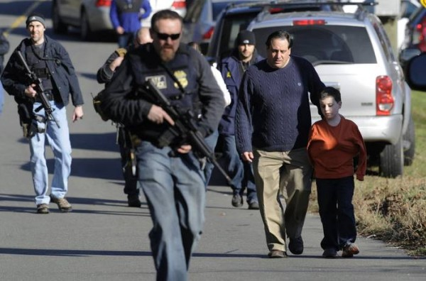 Parents leave a staging area after being reunited with their children following a shooting at the Sandy Hook Elementary School in Newtown, Conn., about 60 miles northeast of New York City, Friday, Dec. 14, 2012. An official with knowledge of Friday's shooting said 27 people were dead, including 18 children. It was the worst school shooting in the country's history. Photo: Jessica Hill/AP Photo