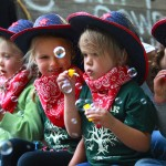 Live Oak preschool students (l to r) Reese MacNeil, Josie Mork, Addison Frost and Alisa Strykowski blow bubbles for the large crowds at the annual Healdsburg Future Farmers Twilight Parade in 2012. (John Burgess/PD)