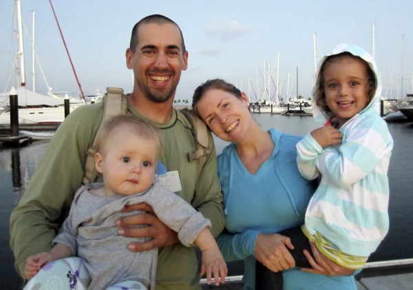 Eric and Charlotte Kaufman with their daughters, Lyra, 1, and Cora, 3.   (AP Photo/Sariah English. File)