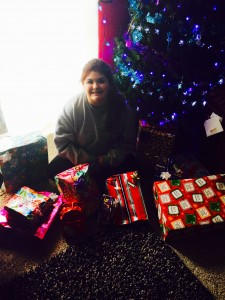 Analycea Miranda sits next to a pile of presents she helped collect for 37 needy children in Sonoma County. (photo provided by family)