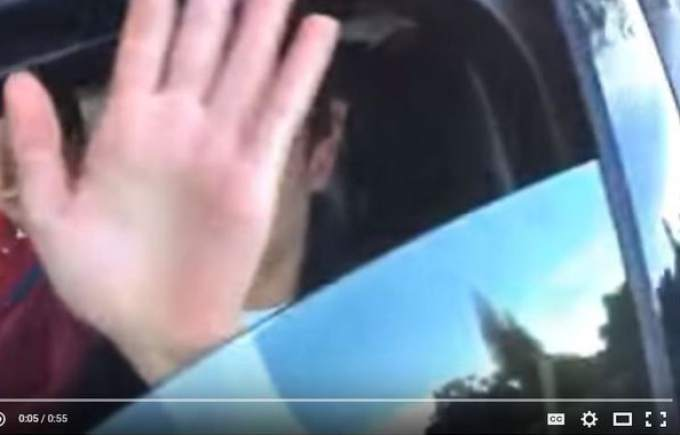 The allegedly hazardous driver shielded himself from Chris Lundstrom's video camera, before things took a turn for the worse, in this still from the YouTube posting. (WWW.YOUTUBE.COM)