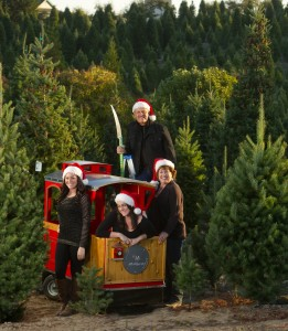 The Garavaglia family (from left) Kellie, 28, Jodi, 21, Paul and Debbie witgh the caboose of the train from their family run Reindeer Ridge Christmas Tree Farm in Sebastopol. (Photo by John Burgess/The Press Democrat)