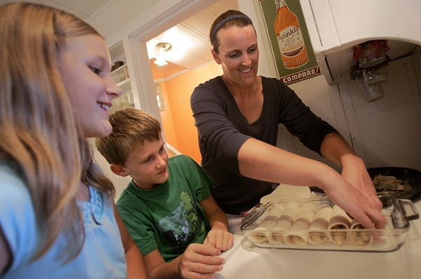 Alison Yoder prepares a chicken tortilla bake with her children Zach, 8, and Audrey Nelson, 11, in their Santa Rosa home on Oct. 23, 2007.  (The Press Democrat / Christopher Chung)