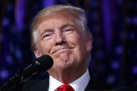 U.S. President-elect Donald Trump smiles as he arrives to speak at an election night rally, early Wednesday, Nov. 9, 2016, in New York. Trump's election has small business advocates expecting changes in government policy on issues like health care and the environment. But they're concerned that gridlock will continue in Washington even though there will be a Republican president and a Congress that looks to be GOP-dominated. (AP Photo/ Evan Vucci)